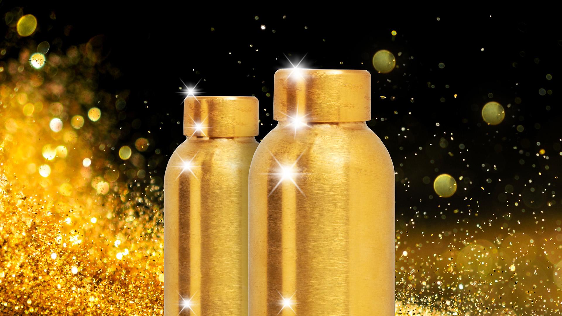 Bottiglie Gold su sfondo glitterato